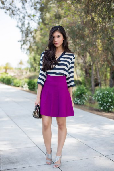 black and white horizontal striped top with purple skirt