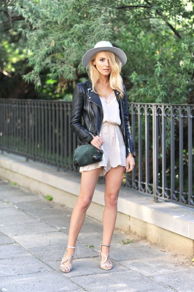 black leather jacket with white blouse and blush flowing high rise shorts