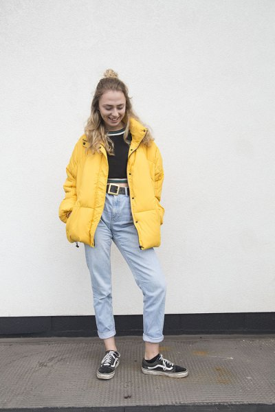 yellow puffer jacket with black cropped sweater and mother jeans