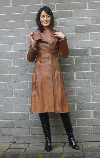 brown leather trench coat with pink sweater with hollow neck