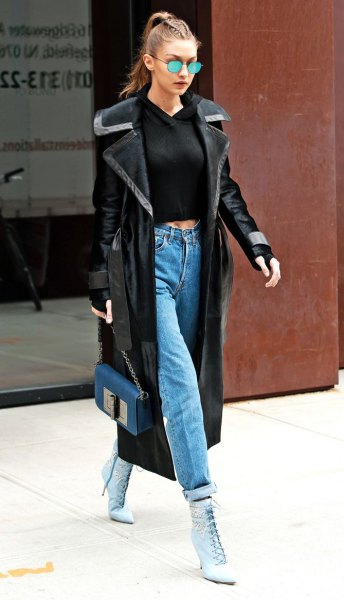 black cropped sweater and cuffed mom jeans