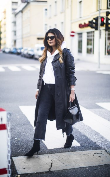 long leather jacket with white hoodie and cropped jeans