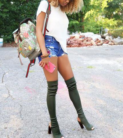 gray heeled boots with white t-shirt and blue high-jeans shorts