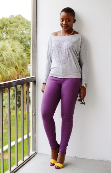 light gray tee with long sleeve boat neck with purple jeans