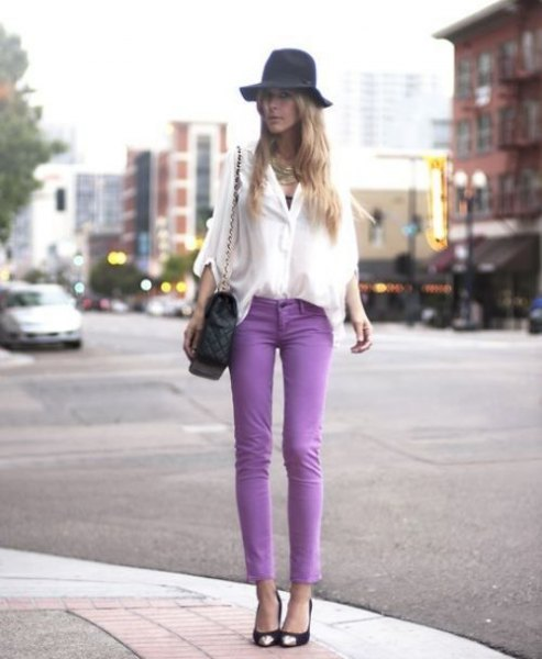 white chiffon with wide sleeves with purple skinny jeans and floppy hat