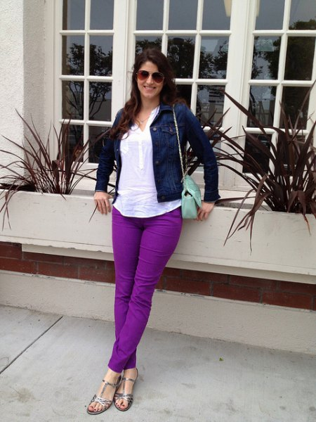 navy blue denim jacket with white top and purple jeans