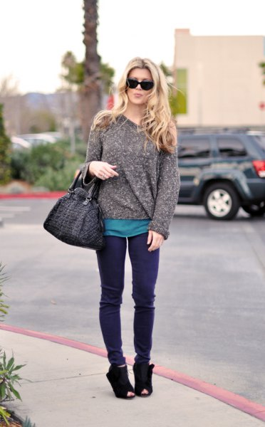 Heather gray chunky sweater with purple jeans and suede shoes
