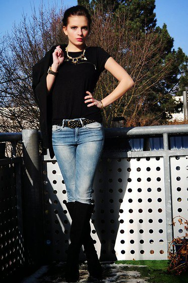 black belt with double belt and knee-high boots