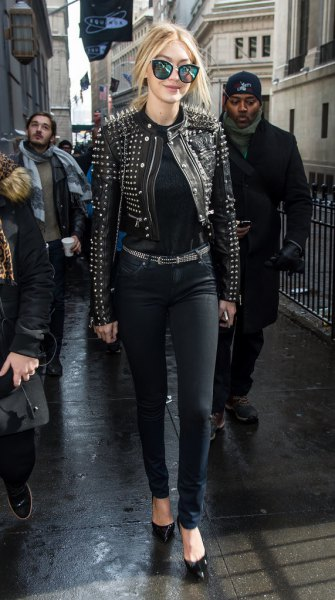 black studded leather jacket with matching belt and slim jeans