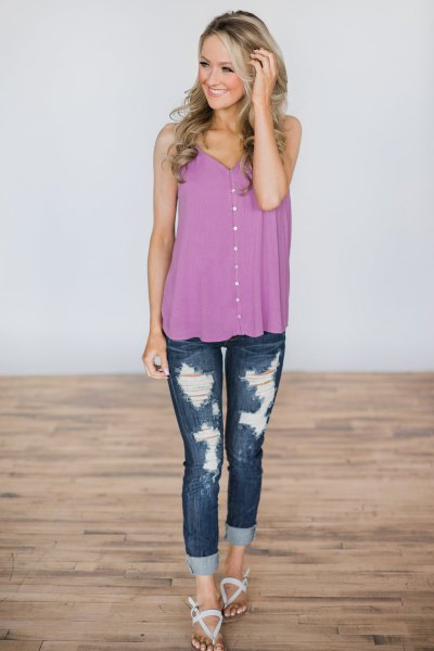 purple button up vest with ripped skinny jeans