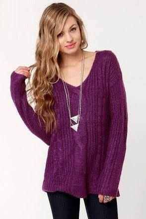 purple v-neck knitted sweater with black skinny jeans