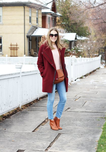 burgundy coat with ivory knitted sweater and light blue skinny ankle