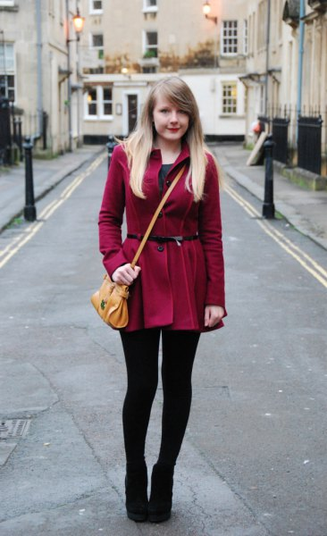 burgundy coat with long fur with leggings and ankle boots