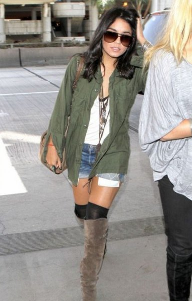 green shirt with white v-top and knee-high boots