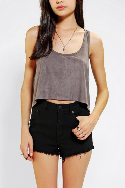 gray cropped vest top with black denim mini shorts
