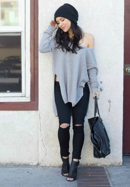 gray sweater with a large shoulder with black leather boots
