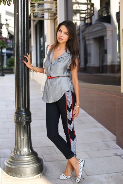 silver sleeveless belt blouse with black cropped pants