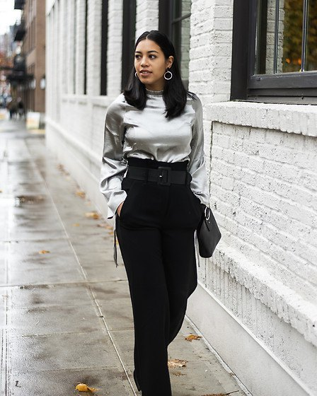 silver metal blouse with black high waist trousers
