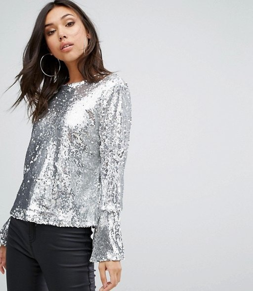 silver colored watch sleeve blouse with black leather pants