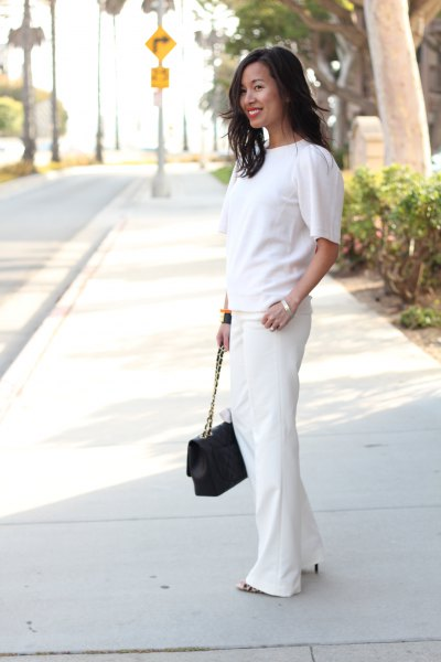 white short-sleeved sweater with wide leg dress pants