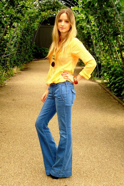 light yellow long sleeved blouse with blue puffed jeans