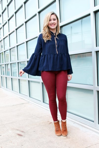 deep blue dress neck blouse with green leggings
