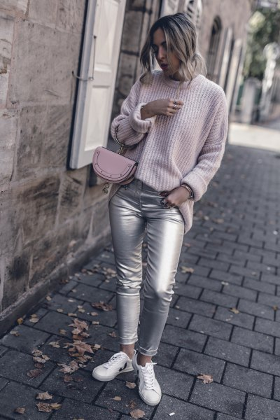 light gray ribbed sweater with crew neck with silver skinny jeans