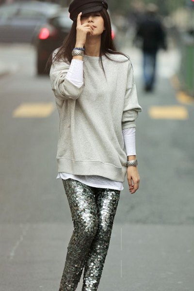light gray sweater with silver sequin trousers