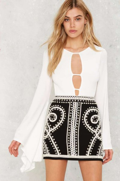 white cutout front watch sleeve bodysuit blouse with black mini skirt