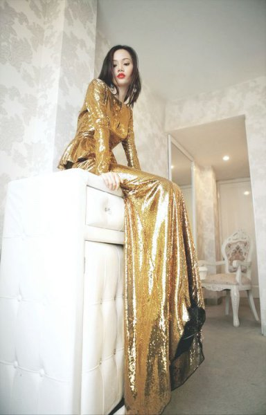 gold long sleeve floor length flowing dress