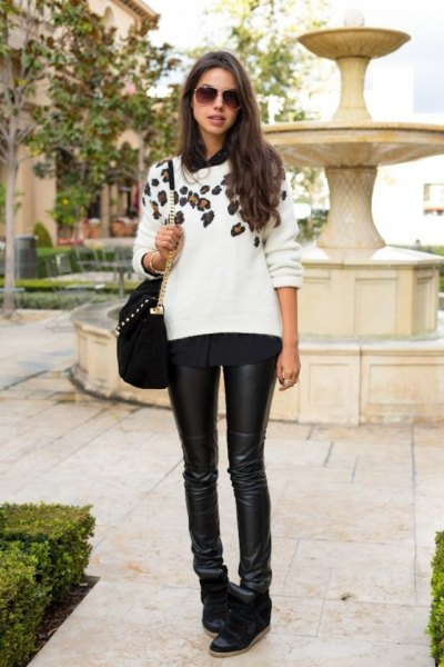 white floral printed knit sweater with black leather clothes and short suede boots