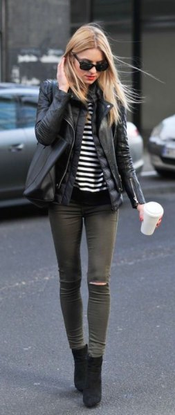 black short boots with leather jacket and gray skinny jeans
