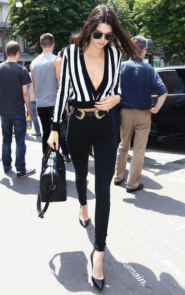 black and white deep v-neck blouse with cowboy belt
