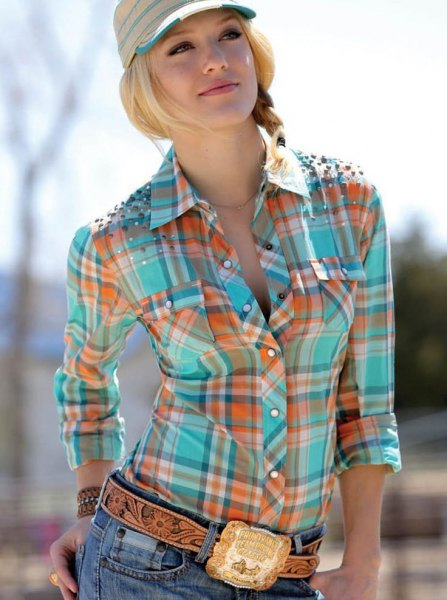 gold cowboy belt with orange and pink checkered shirt
