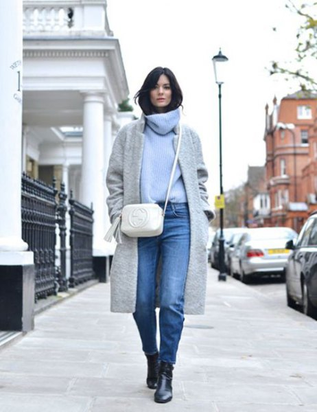 light blue sweater with cabbage neck with gray wool coat and jeans