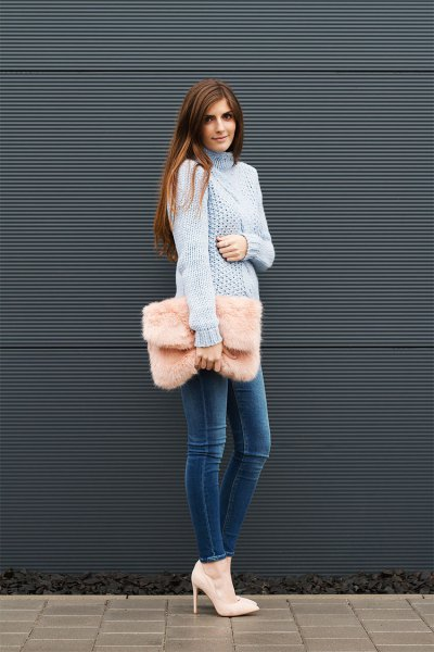 blue turtleneck cable knitted chunky sweater with blue skinny jeans