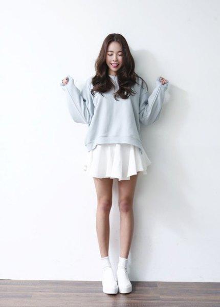 light blue sweater over white mini skater dress