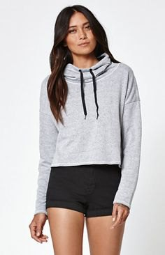 gray light cropped hoodie with black high-rise mini shorts