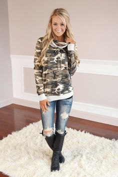 camo hood in hood with ripped jeans and knee-high boots in black leather