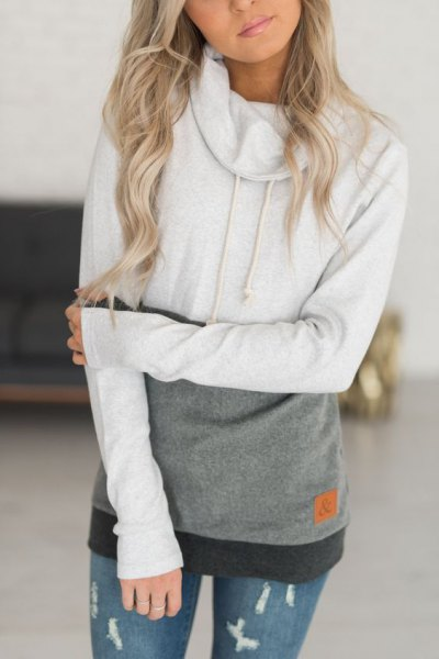 white and gray block cap with ripped skinny jeans