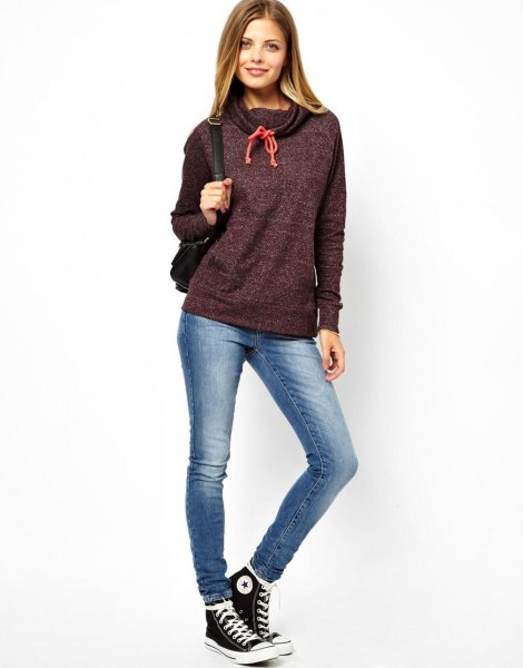 Heather gray cover with sweater with skinny jeans and high top sneakers