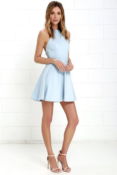 baby blue halter neck fit and flare mini dress with white heels with open toe