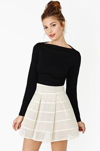black boat neck long sleeve top with light pink mini skater skirt