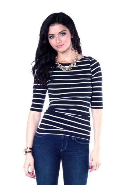 black half-heated striped boat neck top with dark blue skinny jeans