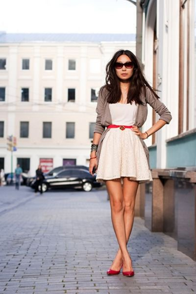 white mini skater dress with gray short blazer and red belt