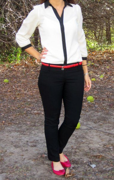 white and black shirt with chinos and narrow belt