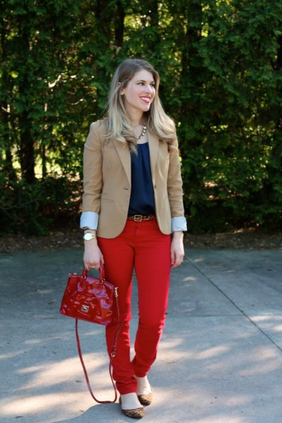 pink pink blazer with navy blouse and red belt