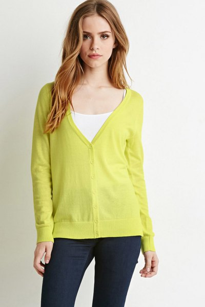 yellow v-neck cardigan with white vest top