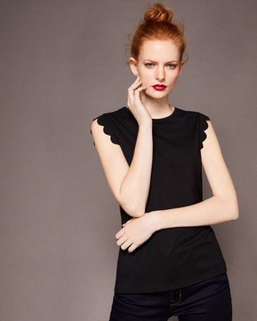 black sleeveless peeled t-shirt with slim jeans