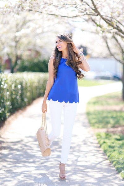 blue peeled sleeveless shirt with white skinny jeans